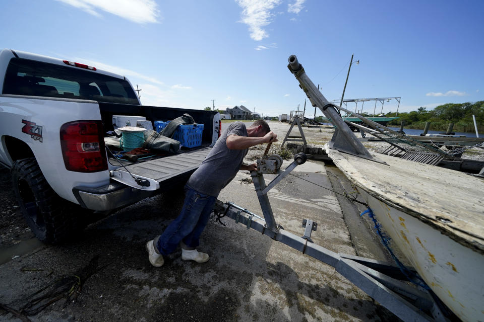 Charles Russ pulls their boat from the water after pulling his crab traps from Bayou Dularge in anticipation of Hurricane Delta, expected to arrive along the Gulf Coast later this week, in Theriot, La., Wednesday, Oct. 7, 2020. (AP Photo/Gerald Herbert)