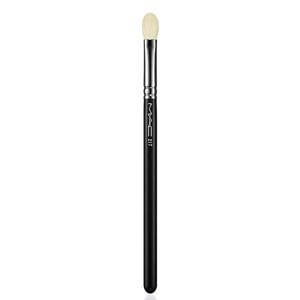 "For really getting concealer to sink in and look natural, Hughes skips traditional concealer brushes. Flat brushes can make your concealer look streaky, so she uses a MAC 217 eyeshadow brush instead. Any fluffy eyeshadow brush would work, she says, since it'll get into every angle around your nose and eyes to blend. $26.5, MAC 217 Blending Brush. <a href=""https://www.maccosmetics.com/product/13804/53988/products/brushes-tools/brushes/eye-brushes/217-synthetic-blending-brush"" rel=""nofollow noopener"" target=""_blank"" data-ylk=""slk:Get it now!"" class=""link rapid-noclick-resp"">Get it now!</a>"