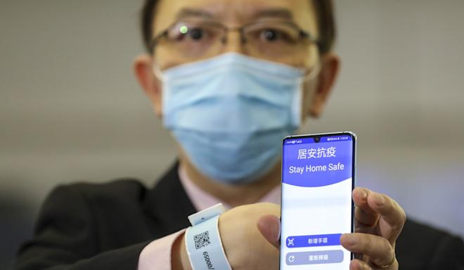 Victor Lam shows the 'Stay Home Safe' app which is connected to the tracking wristband. Photo: Winson Wong
