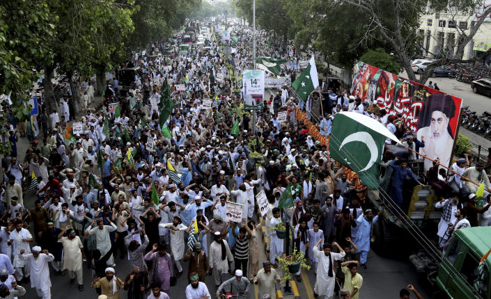 Supporters of Pakistani Islamic radical party rally against India in Lahore, Pakistan, Friday, Aug. 9, 2019. Thousands of activists held peaceful rallies across Pakistan to condemn India and its decisions on Kashmir. (AP Photo/K.M. Chaudhry)