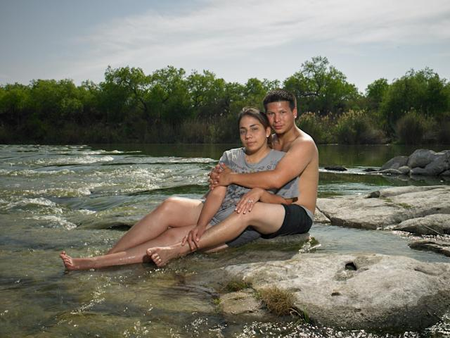 "<p>""Alicia and Allen Alejandro, newlyweds in their 20s, play hooky at an abandoned trailer park on the bank of the Rio Grande. They told me that sometimes the cartel have gunfights right here at this very spot. They supported Clinton."" (Photograph and caption by Naomi Harris) </p>"