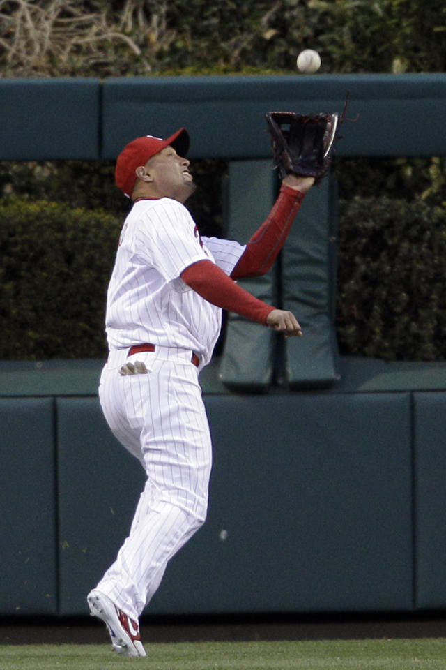Philadelphia Phillies center fielder Shane Victorino catches a deep fly-out by Miami Marlins' Hanley Ramirez in the first inning of a baseball game on Wednesday, April 11, 2012, in Philadelphia. (AP Photo/Matt Slocum)