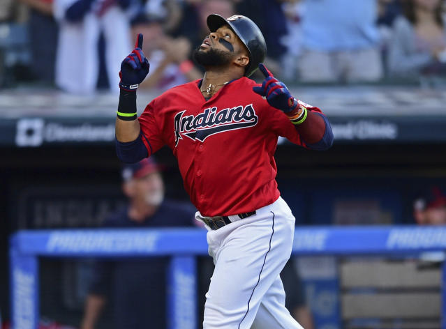 Cleveland Indians' Carlos Santana reacts after hitting a solo home run off Minnesota Twins starting pitcher Kyle Gibson in the fourth inning of a baseball game, Friday, July 12, 2019, in Cleveland. (AP Photo/David Dermer)