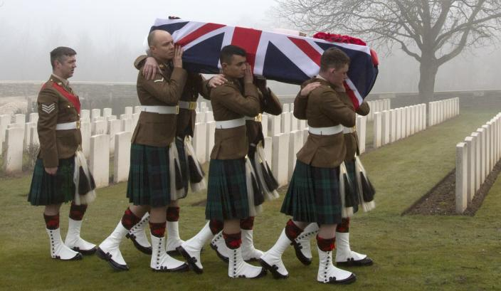 Military pallbearers carry the casket of British World War One soldier William McAleer during a reburial service at the Loos British World War One cemetery in Loos-en-Gohelle, France on Friday, March 14, 2014. Private William McAleer, of the 7th Battalion, Royal Scots Fusiliers, was killed in action on Sept. 26, 1915 during the Battle of Loos. His body was found and identified in 2010 during routine construction in the area and is being reburied with full military honors along with 19 unknown soldiers. (AP Photo/Virginia Mayo)