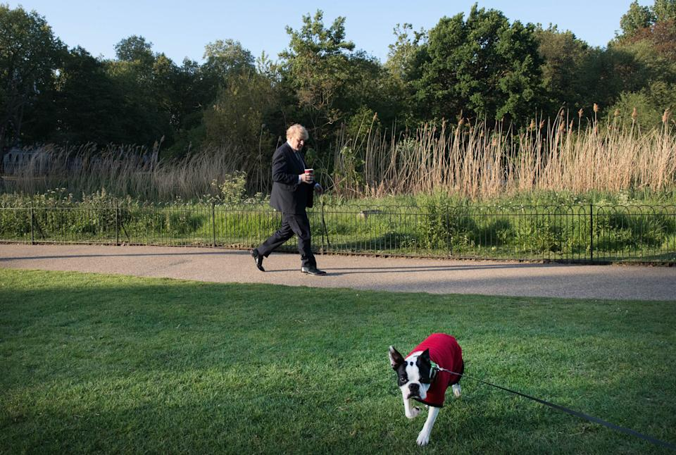 Boris Johnson takes a morning walk in St James' Park on 6 May. (Stefan Rousseau/PA)