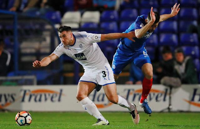 Soccer Football - FA Cup First Round Replay - Tranmere Rovers vs Peterborough United - Prenton Park, Birkenhead, Britain - November 15, 2017 Tranmere Rovers' Liam Ridehalgh in action with Peterborough United's Jack Baldwin Action Images/Jason Cairnduff