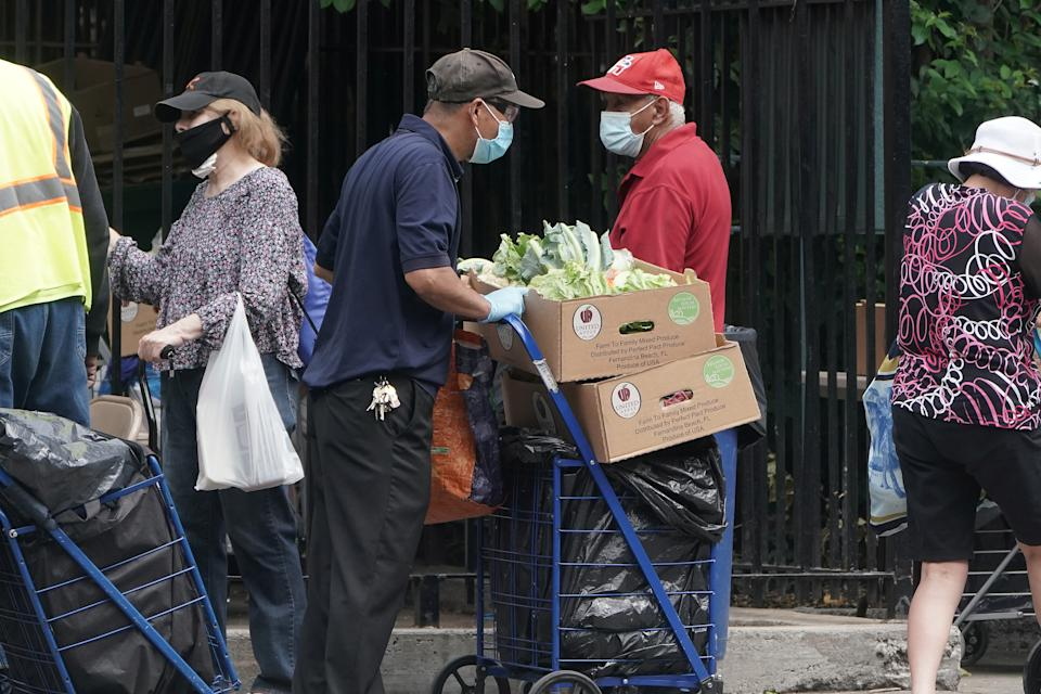 People line up at a food bank following the outbreak of coronavirus disease, the Manhattan borough of New York City, New York, U.S., July 30, 2020. REUTERS/Carlo Allegri