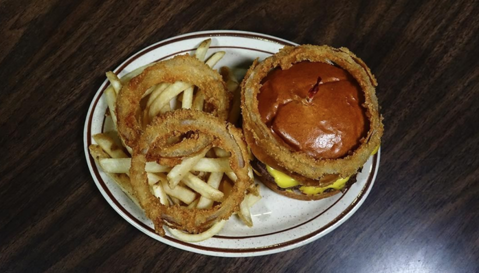 "<p>You'll want to make sure you get a side of onion rings at <a href=""https://bismarckwoodhouse.com/"" rel=""nofollow noopener"" target=""_blank"" data-ylk=""slk:Wood House"" class=""link rapid-noclick-resp"">Wood House</a>, along with one of their amazing burgers of cheese frenchee (basically a deep fried grilled cheese). And it's not just the food that's great, it's also how you order it. Each table has a phone to the kitchen that you use to let them know what you'd like. </p><p><em><a href=""https://www.instagram.com/woodhouserestaurant/"" rel=""nofollow noopener"" target=""_blank"" data-ylk=""slk:Check out Wood House on Instagram."" class=""link rapid-noclick-resp"">Check out Wood House on Instagram. </a></em><br></p>"
