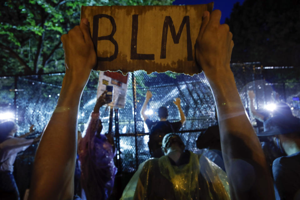 FILE - In this June 4, 2020, file photo, demonstrators protest near the White House in Washington, over the death of George Floyd, a black man who was in police custody in Minneapolis. The federal government deliberately targeted Black Lives Matter protesters via heavy-handed criminal prosecutions in an attempt to disrupt and discourage the global movement that swept the nation last summer in the wake of the police killing of George Floyd, according to a new report released Wednesday, Aug. 18, 2021, by The Movement for Black Lives. (AP Photo/Alex Brandon, File)