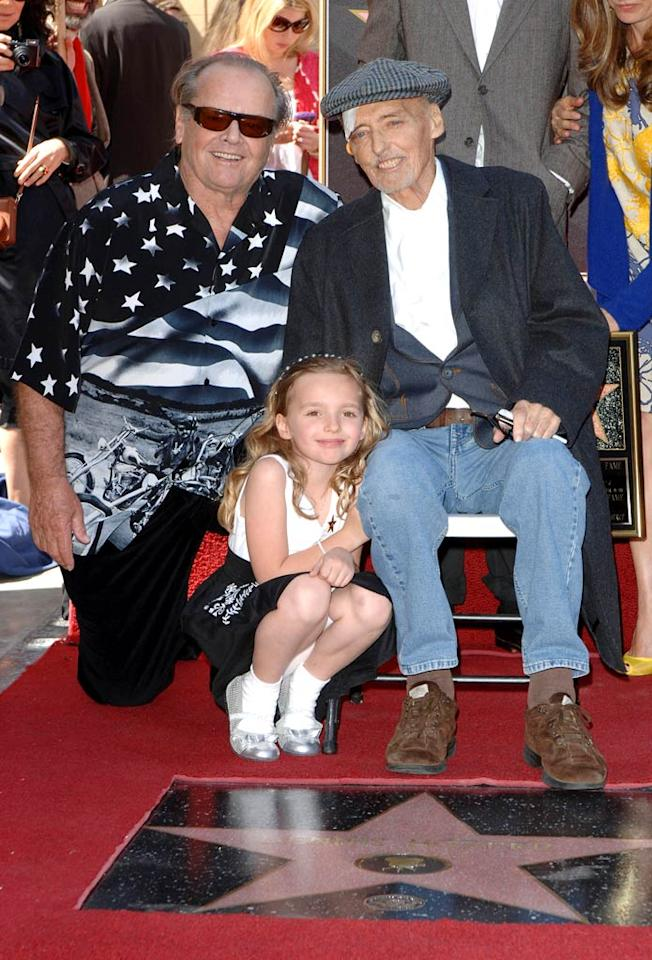"""Dennis Hopper was honored with a star on the Hollywood Walk Of Fame in Los Angeles on Friday. The frail 73-year-old actor and filmmaker, who is suffering from advanced prostate cancer, was joined by family and friends including his 7-year-old daughter Galen and his old buddy and co-star Jack Nicholson (sporting an """"Easy Rider"""" shirt in tribute) at the ceremony. Craig Barritt/<a href=""""http://www.wireimage.com"""" target=""""new"""">WireImage.com</a> - March 26, 2010"""