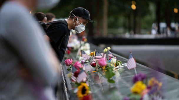 PHOTO: People commemorate victims in the 9/11 attacks at the National September 11 Memorial and Museum in New York, Sept. 11, 2020. (Xinhua News Agency/Getty Images, FILE)
