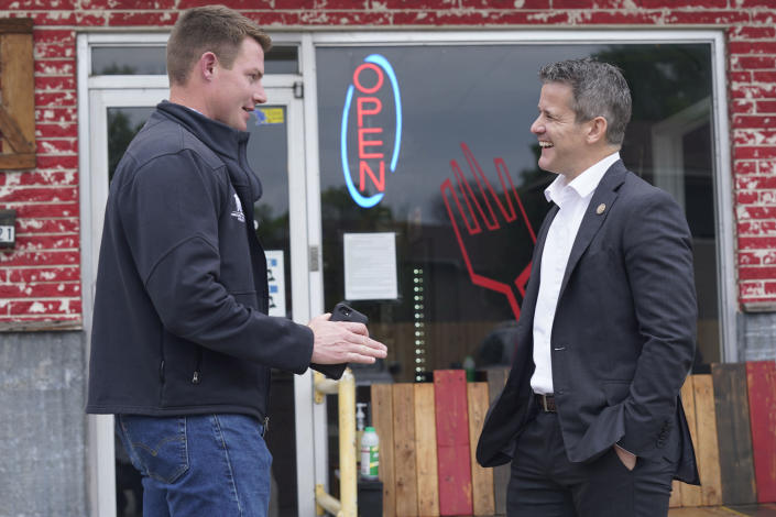 Rep. Adam Kinzinger, R-Ill., right, chats with Texas congressional candidate Michael Wood Tuesday, April 27, 2021, in Arlington, Texas. Wood is considered the anti-Trump Republican Texas congressional candidate that Kinzinger has endorsed in the May 1st special election for the 6th Congressional District. (AP Photo/LM Otero)