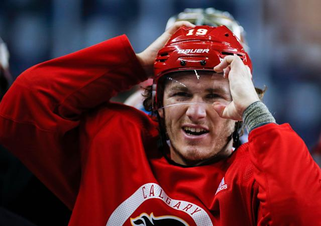 Calgary Flames' Matthew Tkachuk adjusts his helmet during practice in Calgary, Alberta, Tuesday, April 9, 2019. Calgary takes on the Colorado Avalanche in a first-round NHL hockey playoff series beginning Thursday, April 11. (Jeff McIntosh/The Canadian Press via AP)
