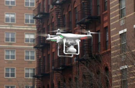 Camera drone flown by Wilson flies near the scene where two buildings were destroyed in an explosion, in the East Harlem section in New York City