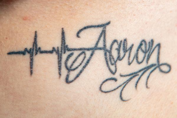 Aaron James Whartonforced Nicola Frost to get tattoos bearing his name all over her body (SWNS)