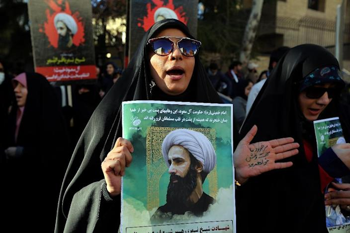 An Iranian woman holds a portrait of Shiite Muslim cleric Nimr al-Nimr during a demonstration against his execution by Saudi authorities, on January 3, 2016 outside the Saudi embassy in Tehran (AFP Photo/Atta Kenare)