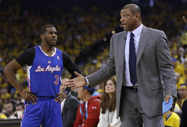 Los Angeles Clippers guard Chris Paul, left, talks to head coach Doc Rivers during the first half in Game 4 of an opening-round NBA basketball playoff series against the Golden State Warriors on Sunday, April 27, 2014, in Oakland, Calif. (AP Photo/Marcio Jose Sanchez)