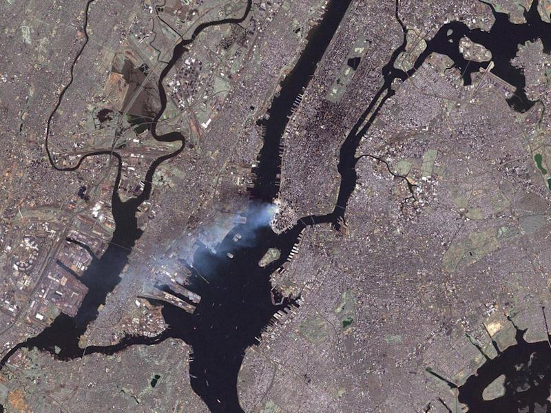 The smoke from the wreckage of the Twin Towers as viewed from space (Nasa)