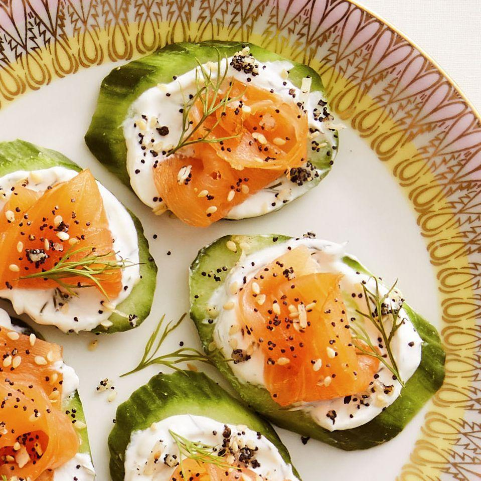 """<p>Serve this refreshing, low-carb appetizer for your next brunch. You can use a store-bought everything bagel-inspired seasoning mix or make your own. </p><p><a href=""""https://www.thepioneerwoman.com/food-cooking/recipes/a35928984/everything-cucumber-smoked-salmon-bites-recipe/"""" rel=""""nofollow noopener"""" target=""""_blank"""" data-ylk=""""slk:Get Ree's recipe."""" class=""""link rapid-noclick-resp""""><strong>Get Ree's recipe.</strong></a></p><p><a class=""""link rapid-noclick-resp"""" href=""""https://go.redirectingat.com?id=74968X1596630&url=https%3A%2F%2Fwww.walmart.com%2Fbrowse%2Fhome%2Fserving-platters-trays%2F4044_623679_639999_2347672_7413764&sref=https%3A%2F%2Fwww.thepioneerwoman.com%2Ffood-cooking%2Fmeals-menus%2Fg37023193%2Fsalmon-recipes%2F"""" rel=""""nofollow noopener"""" target=""""_blank"""" data-ylk=""""slk:SHOP SERVING PLATTERS"""">SHOP SERVING PLATTERS</a></p>"""