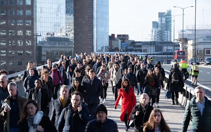 """File photo dated 13/03/2020 of commuters crossing London Bridge, in central London, during the morning rush hour prior to lockdown. Extra training is required to deal with the """"many thousands"""" of redundancies being predicted as furlough support tapers off, the British Chamber of Commerce has said. Issue date: Sunday August 1, 2021. PA Photo. A survey of businesses found that one in five firms plan on letting staff go in response to Sunday's furlough policy change, which will see employers asked to contribute 20% towards the salaries of those whose wages are currently being subsided by the state. The furlough scheme has seen staff whose jobs have been put on hold during the coronavirus pandemic guaranteed 80% of their salaries – to a limit – from the Government. See PA story ECONOMY Furlough. - PA"""