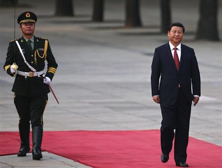 China's President Xi Jinping walks next to a honour guard during the welcoming ceremony for Serbian President Tomislav Nikolic outside the Great Hall of the People in Beijing