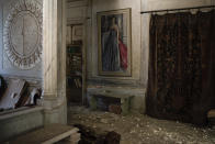 Debris from the ceiling and walls cover the floor of a room in the Sursock Palace, heavily damaged after the explosion in the seaport of Beirut, Lebanon, Friday, Aug. 7, 2020. The 150-year-old palace withstood two world wars, the fall of the Ottoman empire, the French mandate and Lebanese independence. After the country's 1975-1990 civil war, it took 20 years of careful restoration for the family to bring the palace back to its former glory. (AP Photo/Felipe Dana)