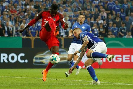 Soccer Football - DFB Cup - Schalke 04 vs Eintracht Frankfurt - Veltins-Arena, Gelsenkirchen, Germany - April 18, 2018 Eintracht Frankfurt's Danny da Costa in action with Schalke's Guido Burgstaller REUTERS/Leon Kuegeler
