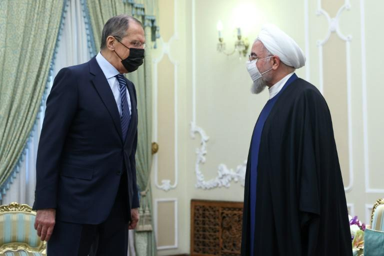 Russian Foreign Minister Sergei Lavrov is received by Iranian President Hassan Rouhani as he puts on a united front with his hosts on bringing the United States back into a troubled 2015 nuclear deal