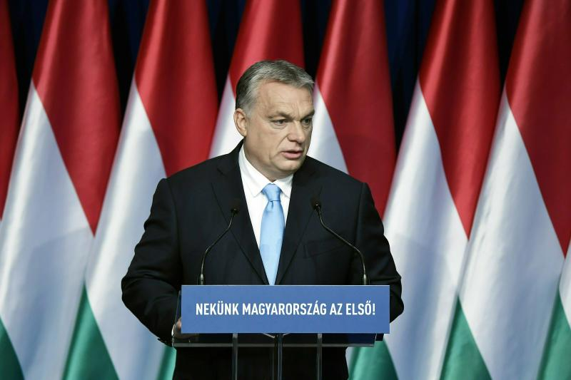 "FILE - In this Sunday, Feb. 10, 2019 file photo, Hungarian Prime Minister Viktor Orban delivers his annual ""State of Hungary"" speech in Budapest, Hungary. The inscription reads: ""For us Hungary is the first!"" Hungary's populist prime minister says calls for his party's expulsion from a European Parliament group serve left-wing rivals. The debate in the European People's Party follows a Hungarian government ad campaign against migration. (Szilard Koszticsak/MTI via AP, File )"