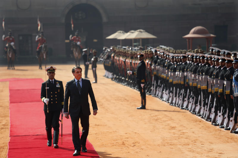 Brazil's President Jair Bolsonaro inspects a joint military guard of honor during his ceremonial reception at the Indian presidential palace in New Delhi, India, Saturday, Jan. 25, 2020. Bolsonaro is this year's chief guest for India's Republic day parade. (AP Photo/Manish Swarup)