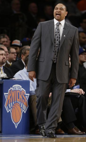 Golden State Warriors' Mark Jackson calls out to his team during the first half of an NBA basketball game against the New York Knicks, Wednesday, Feb. 27, 2013, in New York. (AP Photo/Frank Franklin II)