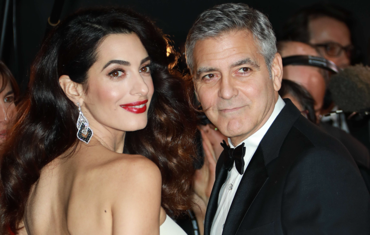 George and Amal Clooney have just become parents to twins. [Photo: LAURENTVU/SIPA/REX/Shutterstock]
