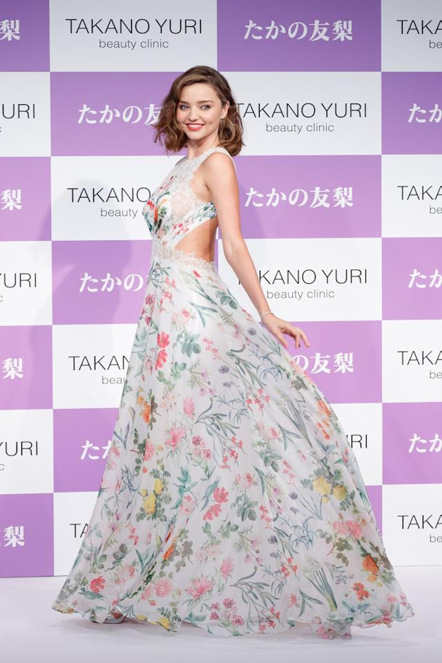 <p>Miranda was completely radiant in a floral maxi dress by Todashi Shoji.<br /><i>[Photo: Getty]</i> </p>