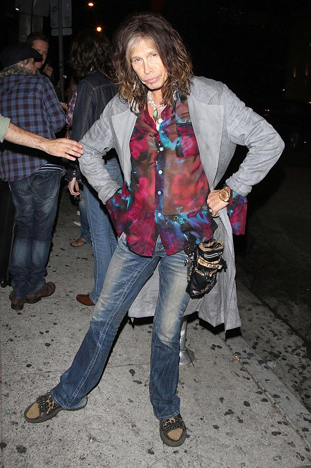 """We've grown accustomed to seeing Steven Tyler rock out in eyesore-inducing blouses like this one over the years, but we'll never accept the Aerosmith frontman's desire to sport socks with sandals ... especially in public. Yes, the combo is probably comfy (not that we'd know!), but it's undoubtedly one of the most offensive fashion crimes one can commit. (9/19/2012)<br><br><a target=""""_blank"""" href=""""http://music.yahoo.com/blogs/reality-rocks/steven-tyler-why-joined-quit-american-idol-233049983.html"""">Tyler on why he joined -- and quit -- 'Idol'</a>"""
