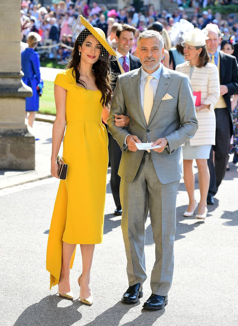 Amal Clooney arrive at St George's Chapel at Windsor Castle before the wedding of Prince Harry to Meghan Markle on May 19, 2018 in Windsor, England.