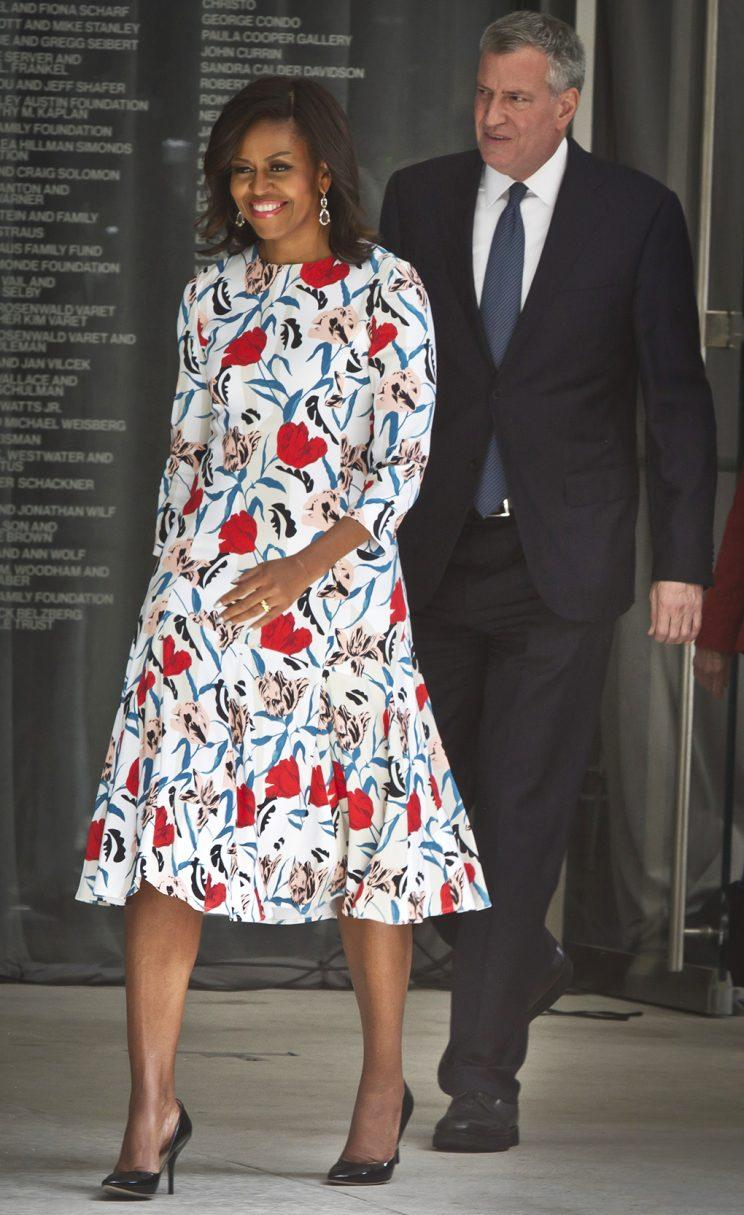 First Lady Michelle Obama arrives at a Whitney Museum event in 2015 wearing a printed dress by Thakoon. (AP Photo/Bebeto Matthews)