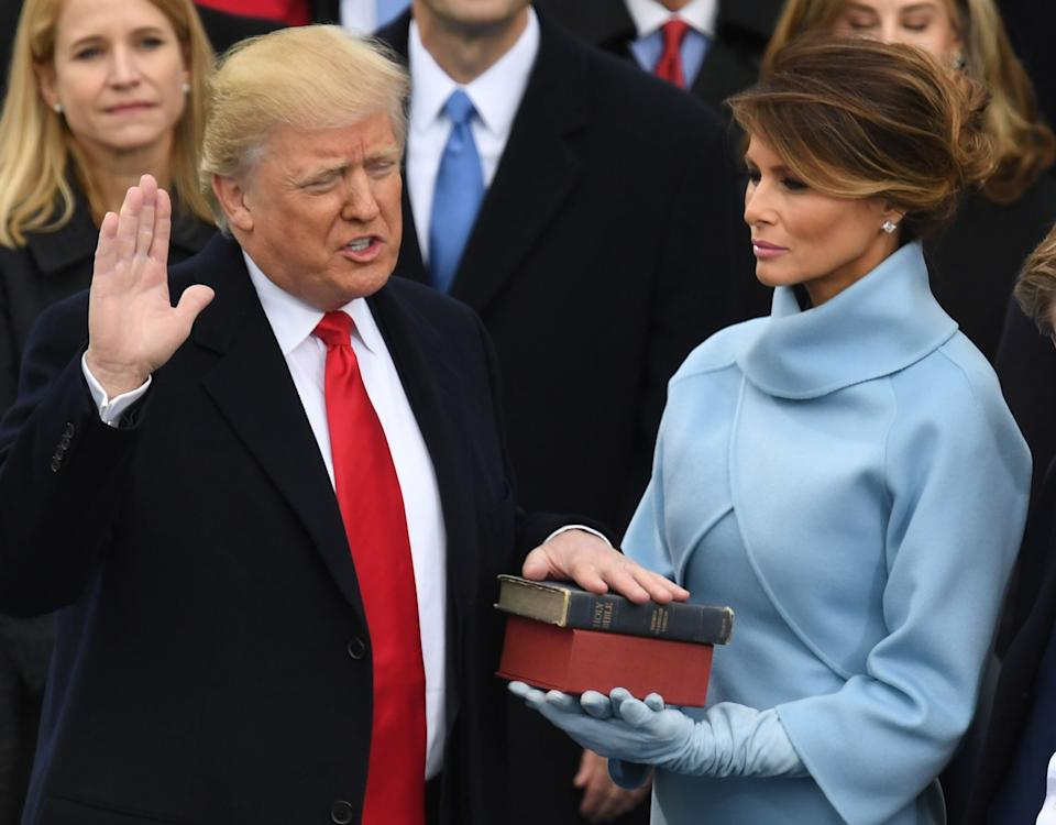 Melania Trump holds the Bible as her husband Donald Trump is sworn in as president on 20 January, 2016  (Photo by Mark RALSTON / AFP) (Photo by MARK RALSTON/AFP via Getty Images)AFP via Getty Images