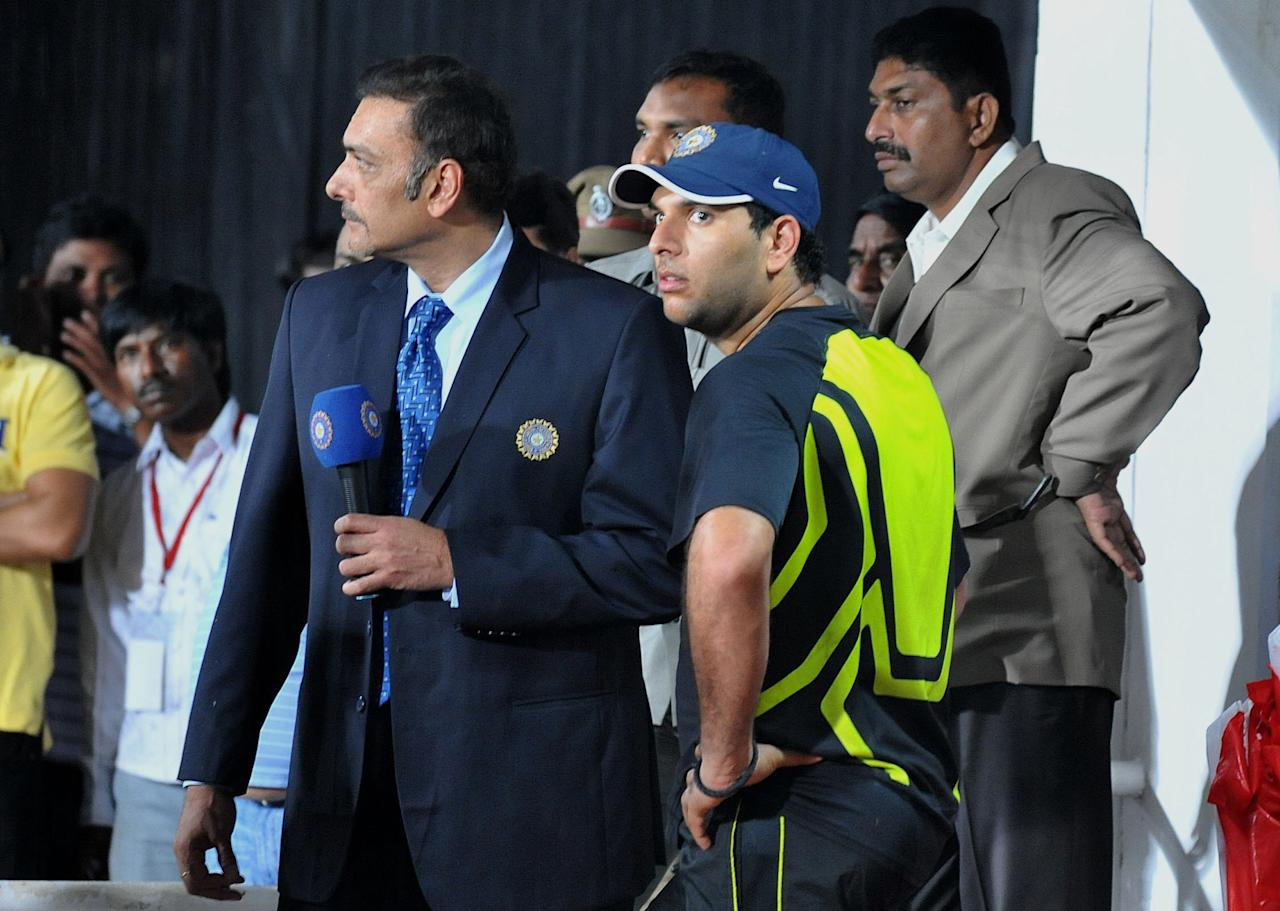 Indian commentator Ravi Shasthri (L)  talks to cricketer Yuvraj Singh(R) prior to the start of the first Twenty20 cricket match between India and New Zealand at Dr. Y.S. Rajasekhara Reddy Cricket Stadium in Visakhapatnam on September 8, 2012. AFP PHOTO / Noah SEELAM        (Photo credit should read NOAH SEELAM/AFP/GettyImages)