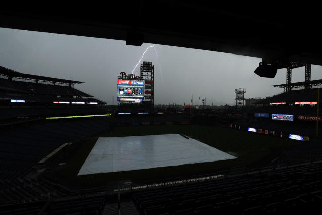 Lightning strikes near Citizens Bank Park during a storm before a baseball game between the Philadelphia Phillies and the Baltimore Orioles, Tuesday, July 3, 2018, in Philadelphia. (AP Photo/Matt Slocum)