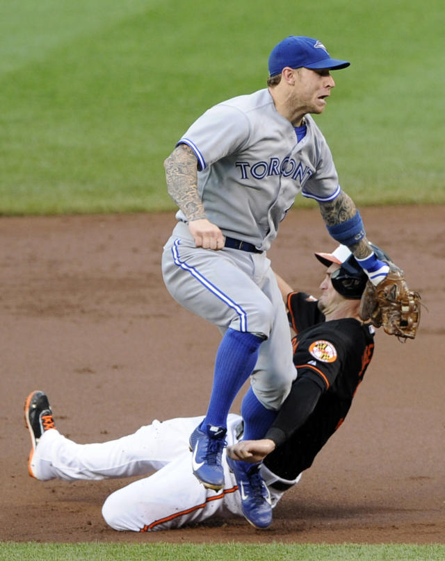 Baltimore Orioles' Caleb Joseph, bottom, is out against Toronto Blue Jays second baseman Brett Lawrie, top, during the third inning of a baseball game on Friday, June 13, 2014, in Baltimore. (AP Photo/Nick Wass)