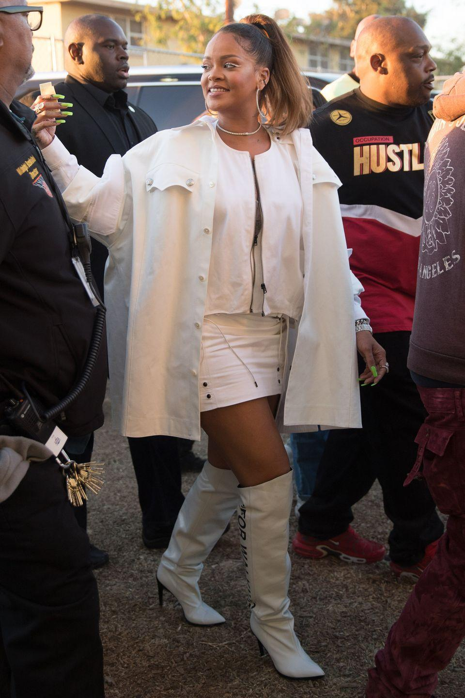 "<p>In a white oversized shirt over a cropped zip-up jacket and mini skirt by Tom Ford, Off-White ""For Walking"" boots, hoop earrings, and a diamond choker necklace after performing with Kendrick Lamar at the annual TDE Christmas Concert in Watts, CA.</p>"