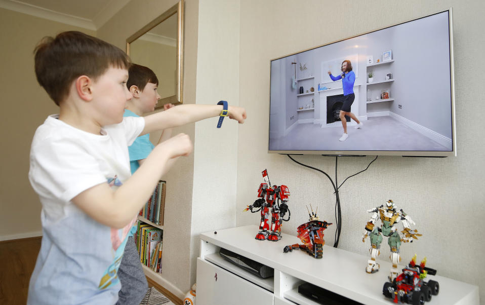 Ben and Isaac Rickett follow P.E with Joe, a fitness workout by Joe Wicks that is aimed at children that are being home schooled due to Covid-19. (Photo by Martin Rickett/PA Images via Getty Images)