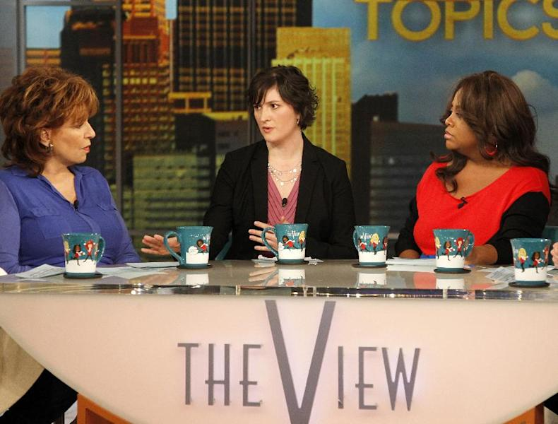 """Georgetown University law student and activist Sandra Fluke, center, speaks as co-hosts Joy Behar, left, and Sherri Shepherd listen during an appearance on the daytime talk show, """"The View,"""" Monday, March 5, 2012 in New York. Fluke talked about conservative radio host Rush Limbaugh and the comments he made on his program after she testified to Democratic members of Congress in support of a requirement that health care companies provide coverage for contraception. Fluke told ABC's """"The View"""" on Monday that she hasn't heard from Limbaugh since he issued a written apology late Saturday. (AP Photo/ABC, Lou Rocco)"""