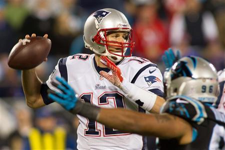 Nov 18, 2013; Charlotte, NC, USA; New England Patriots quarterback Tom Brady (12) throws a pass during the third quarter against the Carolina Panthers at Bank of America Stadium. The Panthers defeated the Patriots 24-20. Mandatory Credit: Jeremy Brevard-USA TODAY Sports