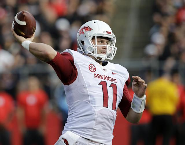 Arkansas quarterback AJ Derby throws a pass during the first half of an NCAA college football game against Rutgers in Piscataway, N.J., Saturday, Sept. 21, 2013. (AP Photo/Mel Evans)