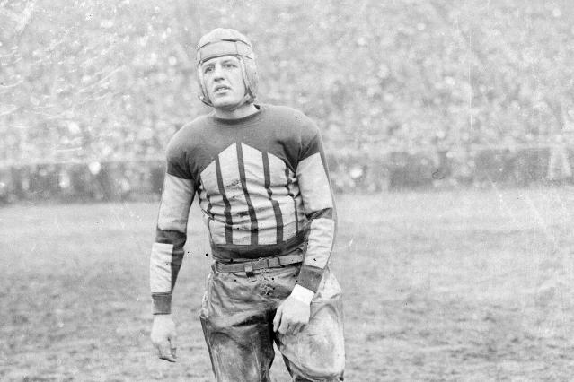 """FILE - This is a 1925 file photo showing Chicago Bears football player Harold """"Red"""" Grange. The Galloping Ghost, Red Grange, was Americas football icon, but from his years as a college star at Illinois. In 1925, after the Illinis season concluded, he signed with the Bears and became the top attraction on the pro level. (AP Photo/File)"""