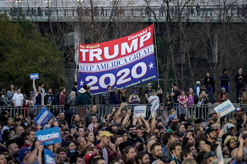 Supporters of President Donald Trump used a large banner to make their presence felt at a Sanders rally on Monday in Austin, Texas. Taking advantage of open primary rules in several states, GOP activists seem primed to try to roil the waters in the Democratic race. (Photo: Drew Angerer via Getty Images)