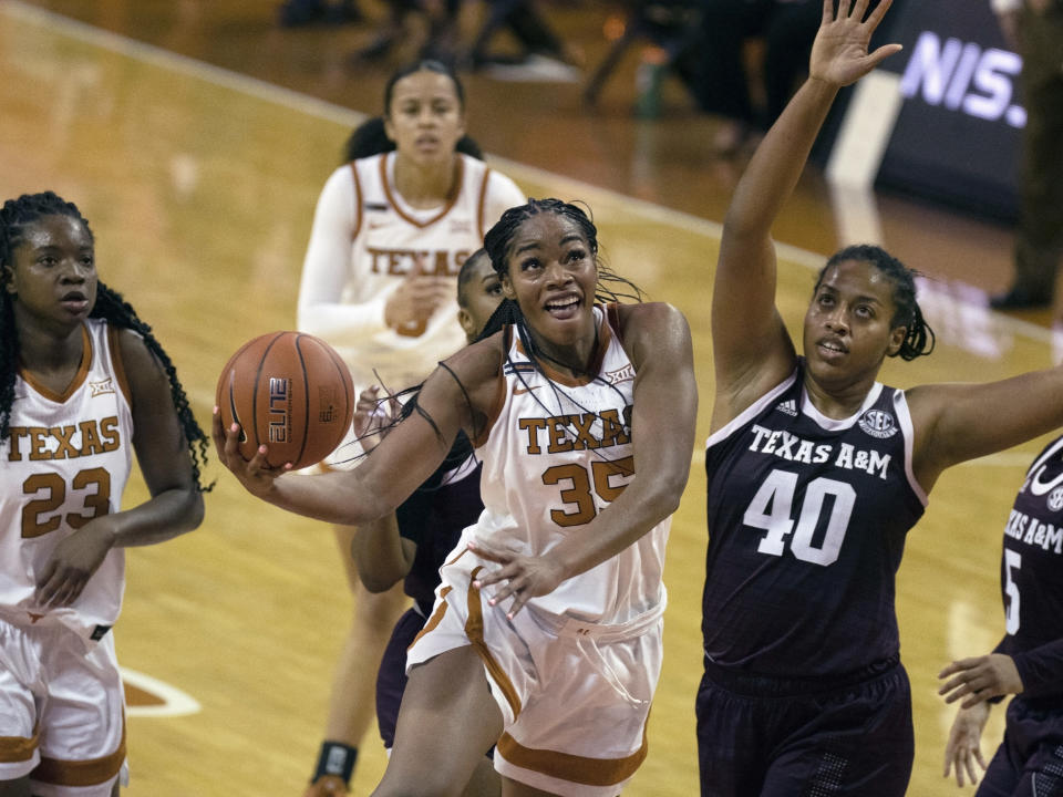 FILE - In this Dec. 6, 2020, file photo, Texas center Charli Collier (35) goes up to shoot against Texas A&M center Ciera Johnson (40) during the first half of an NCAA college basketball game in Austin, Texas. The Dallas Wings selected Collier with the first pick in the WNBA draft Thursday, April 15. (AP Photo/Michael Thomas, File)