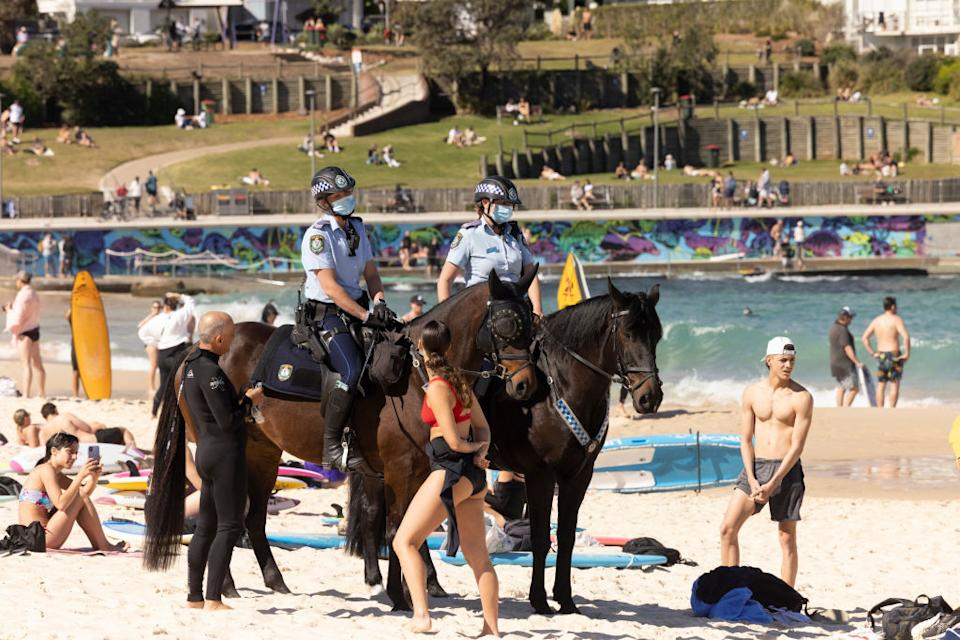 Mounted Police patrol at Bondi Beach as part of public health order compliance operations.