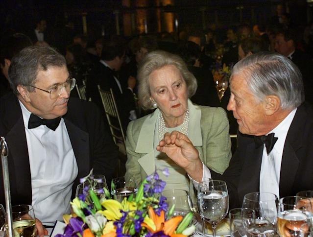 FILE - In this May 22, 2001, file photo, CNN chairman and CEO Tom Johnson, left, joined at right by retired Washington Post Executive Editor Ben Bradlee talk with Katharine Graham, chairman of the Washington Post Company at a Reporters Committee for Freedom of the Press dinner in New York. On Monday, Aug. 5, 2013, the Washington Post announced the paper has been sold to Amazon founder Jeff Bezos. One of key dates in the history of The Washington Post was when Graham died at age 84 in 2001. (AP Photo/J. Scott Applewhite, File)